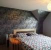 Gestaltung eines Schlafzimmers mit Mustertapete
